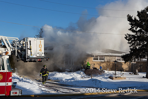 heavy smoke from single family house on fire