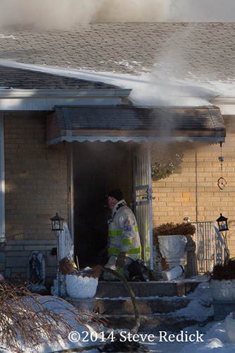 fire chief at door of house fire