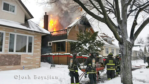 Chicago firefighters fight winter house fire