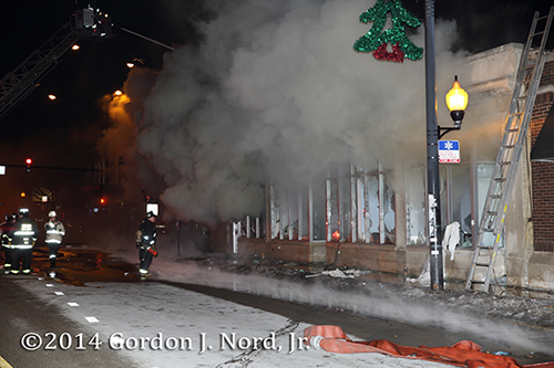heavy smoke pours out of commercial store on fire in Chicago at night