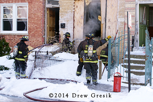 Chicago firefighters fight winter building fire