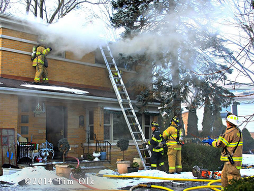 Highland Park firefighters fight house fire 1-15-14