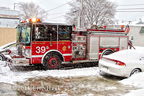 Chicago firemen fight house fire in snow storm