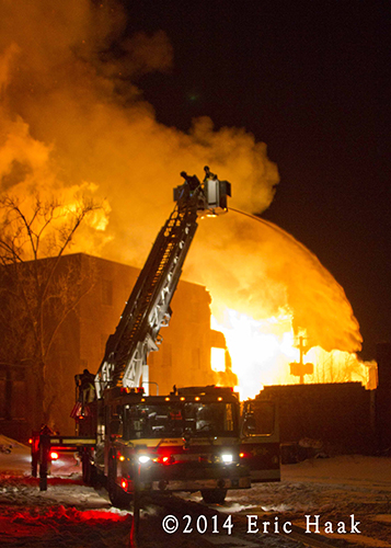 massive warehouse fire with wall of flames