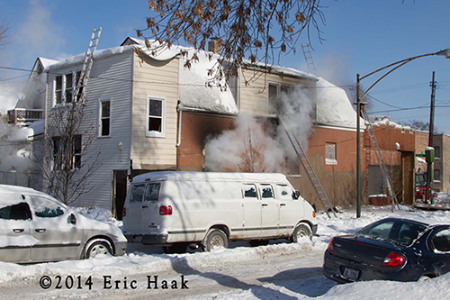 Chicago firemen fight house fire in sub zero temperatures