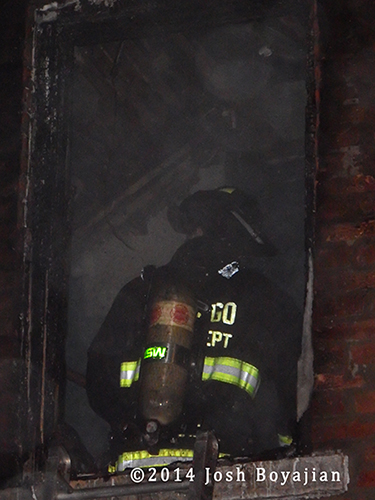 fireman inside burning building