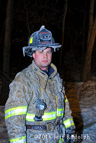 fireman with ice covered helmet
