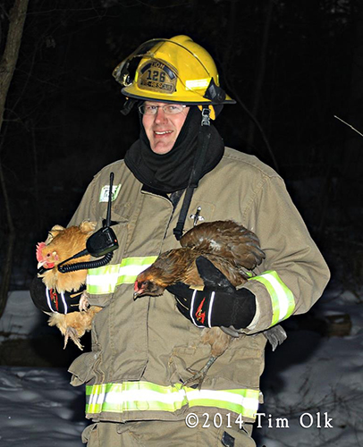 fireman rescue chickens from house fire
