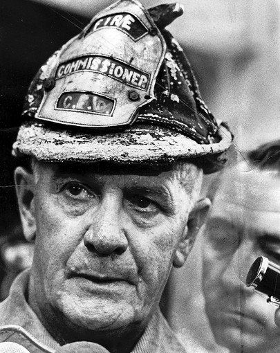 Fire Commissioner Robert Quinn regularly responded to fires wearing a battered old helmet. (Chicago Tribune file photo)