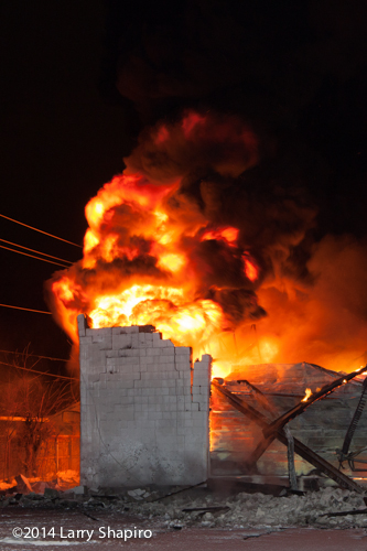fire ball erupts from tire warehouse