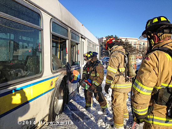 firemen extinguish transit bus fire