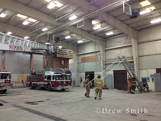 firefighter training with big ladders