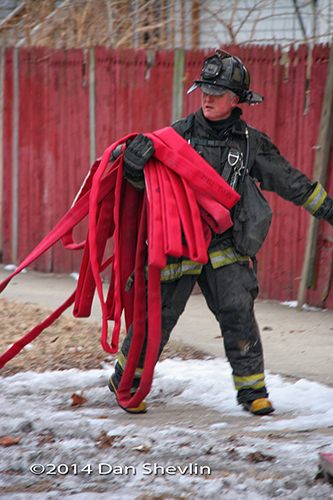 fireman carrying hose
