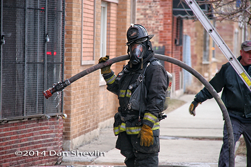 firefighter with mask and hose