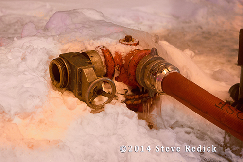 fire hydrant in snow being used