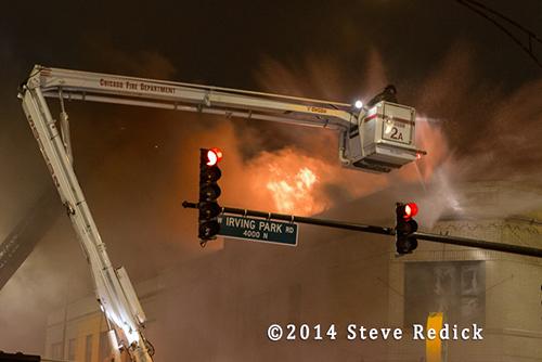 firemen battle night fire in the snow