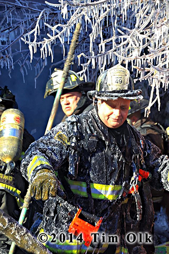 firemen covered with ice at fire scene