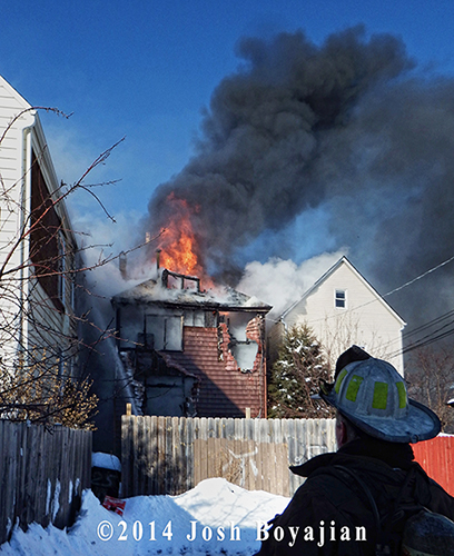 fire blows out the roof of Chicago two-flat