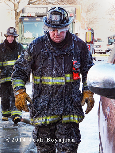Chicago firefighter covered with ice