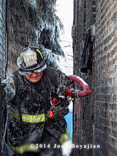 fireman covered with ice at winter fire