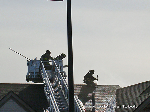 firemen working on a roof