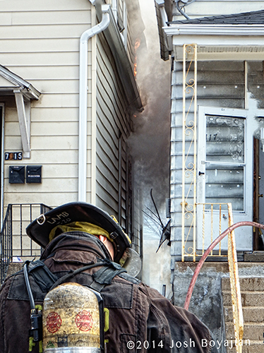 fireman with smoke between two houses