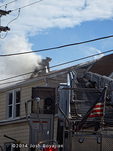 fireman on roof of fire building