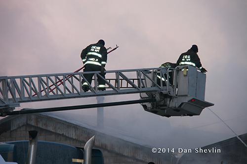 fire scene with trucks at dawn