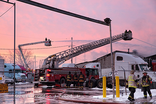 fire scene with trucks at dawn