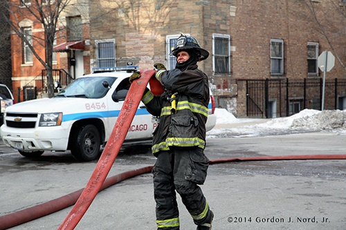 fireman rolling hose