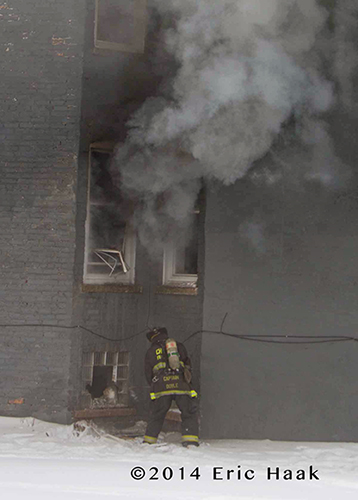 Chicago fireman at building fire scene