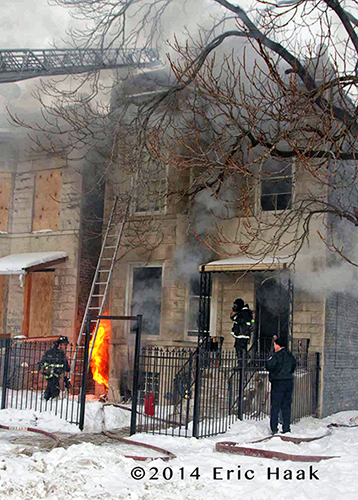flames shooting out of basement window