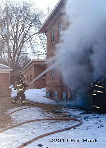 firemen battle apartment building fire