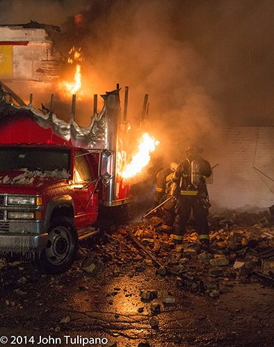 firemen with truck fire