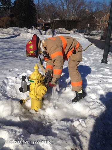 fireman at fire hydrant in snow