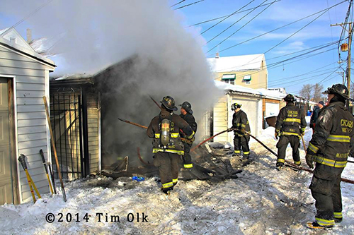 firefighters working garage fire in the snow