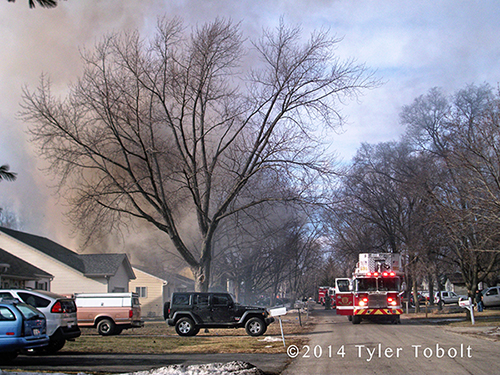 heavy smoke from suburban house fire