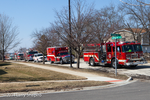 fire trucks lined up at fire scene