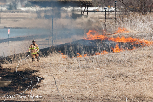 fireman at grass fire
