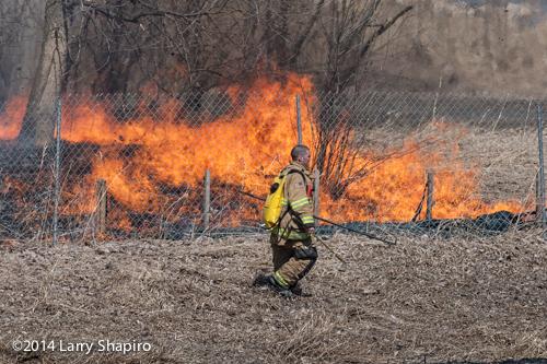 fireman at grass fire