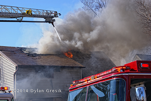 fire through the roof of a house