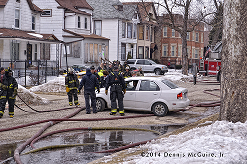 car on hose at fire scene