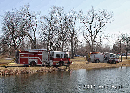ire engines draft water from a pond