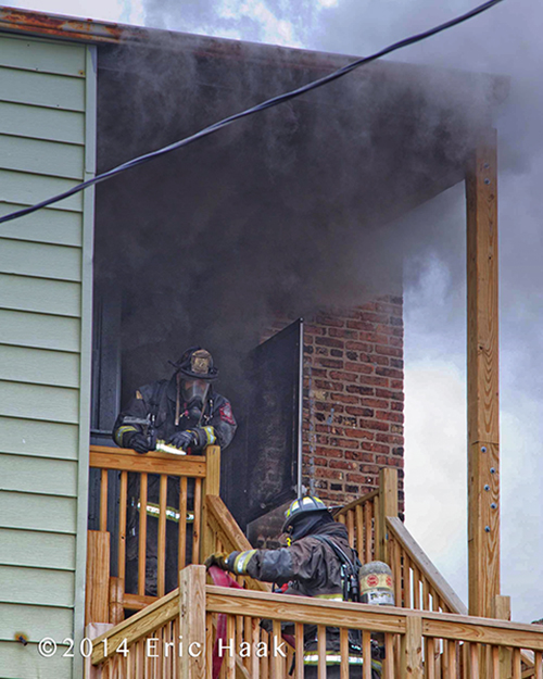 firemen with heavy smoke overhead
