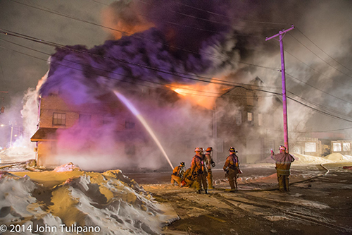 firemen work at huge winter fire at night