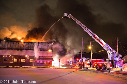 Pierce tower ladder working at fire scene