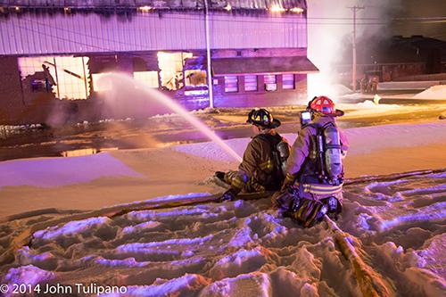 firemen at winter fire scene