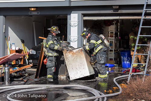 firemen at fire scene with dryer