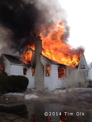 house fully engulfed with fire