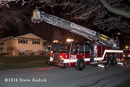 E-ONE tower ladder at night fire scene